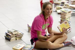 1_A_GirlOrganizing Books_byAbbyTierney_IMG_0077_FINAL