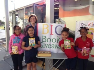 Golden Terrace Intermediate's Meda Specialist Tiffany Weeks with students at K is for Kids' Big Book Giveaway. Photo by Brigitte Papita, K is for Kids' student spokesperson and FGCU intern!
