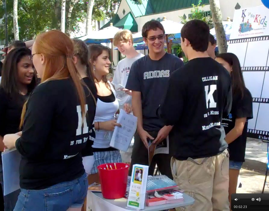 Haylee, at center, stands next to her brother Matthew as the Teen Advisory Team prepared to help children write storyboards for their giant filmstrip on canvas at Naples CityFest 2010.