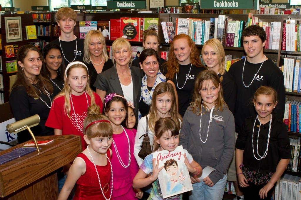 "The First Lady of Florida Ann Scott stands with K is for Kids' Founder Karen D. Clawson (at left) and HarperCollins published author Margaret Cardillo and are surrounded by children of all ages at the 2011 ""Kids Celebrate Reading"" Book Fair held at Barnes & Noble, Waterside Shops in Naples. Standing in the back row are members of K is for Kids' Teen Advisory Team Council, and amongst this year's graduating seniors. From left to right: Marina Moussa, Tyler Clevett, Amber Valcante, Haylee Lamb, Erin Clawson and Matthew Colligan. The children are featured in the third commemorative K is for Kids' young authors book, ""Wishes, Dreams & Who Inspires Me."" The theme of the book fair in honor of the First Lady and Audrey Hepburn, the subject of Ms. Cardillo's biographical book ""Just Being Audrey."" All participants were given white beads in honor of the late actress' fondness for fashion.."