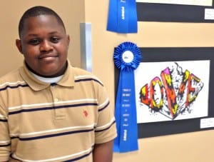 "Fiery ""Love"" catapulted Andrezione ""Dre"" Perry, a 6th-grader at Gulf view Middle School into first place in the ""Power of the Word"" Art Exhibition's single word category."