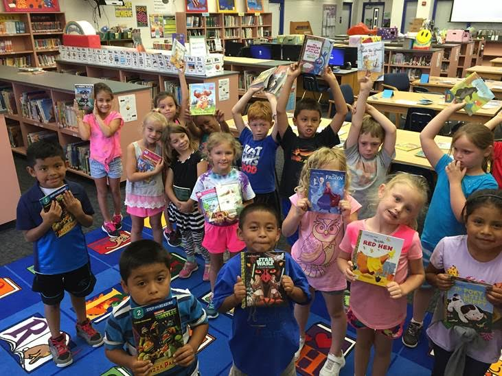 EVG First Graders with books from K is for Kids Rising Readers program 2016