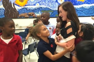 1 Youngsters give big hugs at book giveaway by Operation Outreach