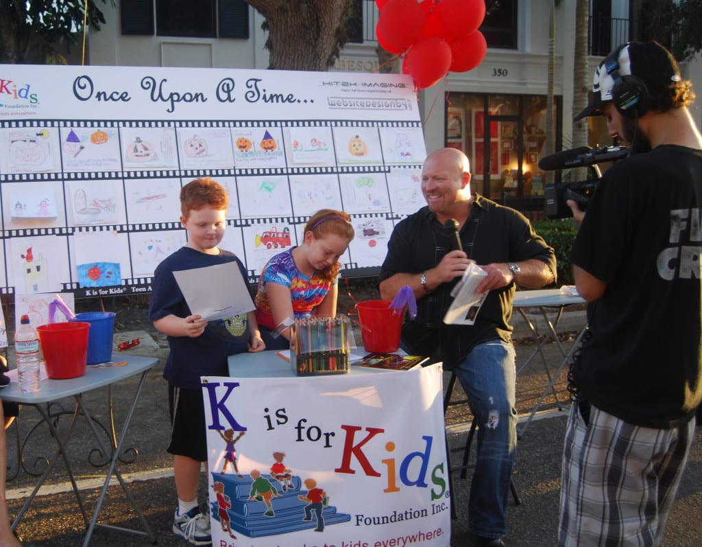 "Chuck Ardezzone became an impassioned supporter of K is for Kids at CityFest 2010 when Naples International Film Festival invited our student leaders to participate in its ""Films and Flavors"" on Fifth Avenue. Here Chuck interviews children and teens participating in K is for Kids' ""storyboards on canvas"" event."