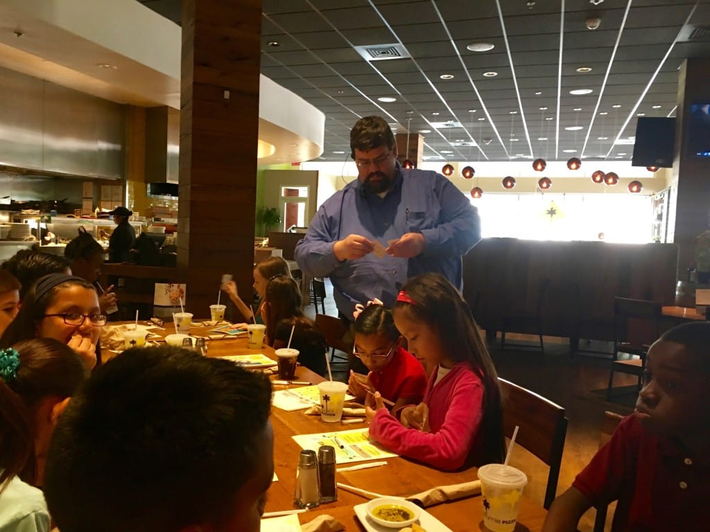 AES at CPK - Mgr. Rich Hallas gives honorees cards for complimentary kids meal